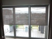 Sunscreen roller blinds installed to bifold doors in a ...