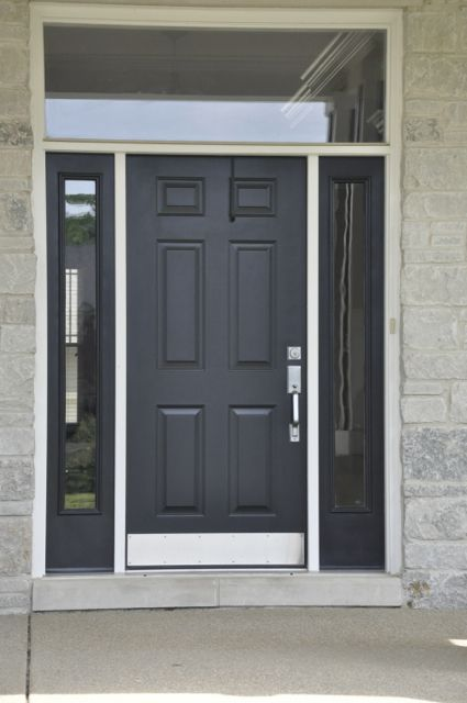 Simple black front door with glass surround
