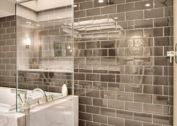 Silver subway tile and shower great for reflecting light in our windowless bathroom marble tub deck design big next to  also love that modern pinterest