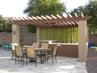 We built this Stained Wooden Gazebo with Stucco pillars ...
