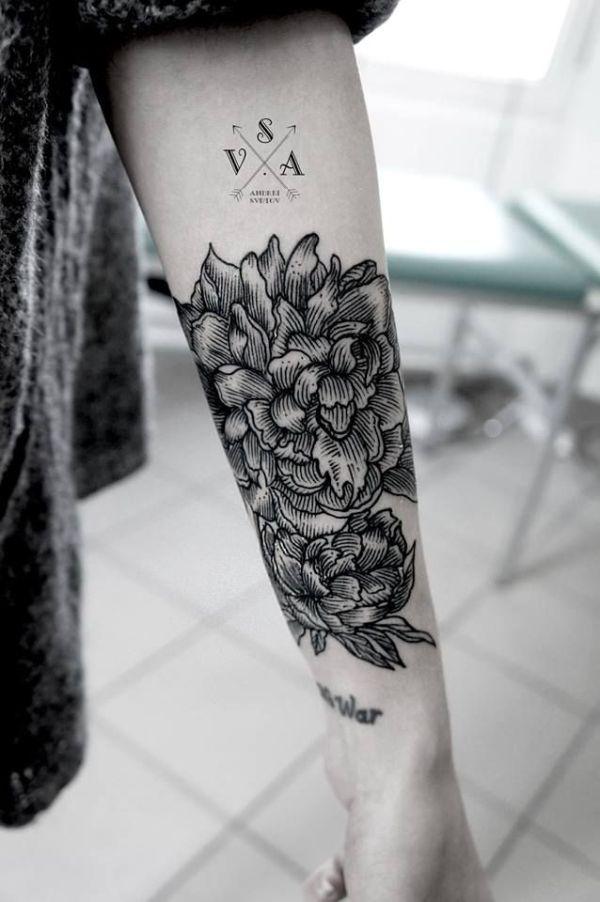 women forearm tattoo