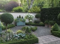 Esme Auers garden, Surrey. Tightly clipped boxwood hedging ...