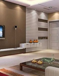 Living room theater design with brown wall color paint also sofa and red benches besides glass table white wooden door standing puraniks vartak nagar housing group present their new plan named rh pinterest