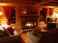 Inviting living room with wood burning fireplace - West ...