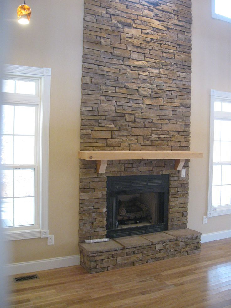 Fabulous Floor To Ceiling Stacked Stone Fireplace Design