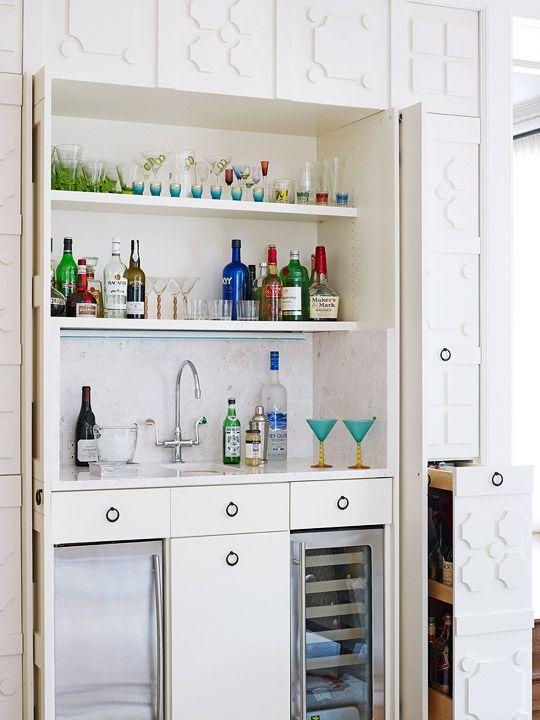 Builtin bar is concealed behind wood paneling Designer