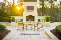 Outdoor fireplace, seating wall, stucco and travertine ...