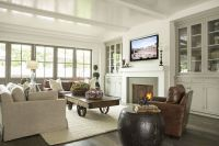 Cozy family room with dark wood floors, leather chairs ...
