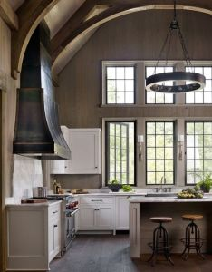 Elegant traditional kitchen with high ceilings and black steel windows arches circular chandelier above the island dungan nequette architects also portfolio architecture coastal wall tone rh pinterest