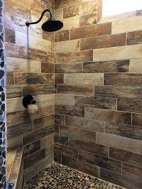 Wood look tile shower with pebble floor | Bathroom Tiles ...