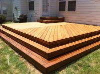 New deck with herringbone decking pattern. No railing with ...
