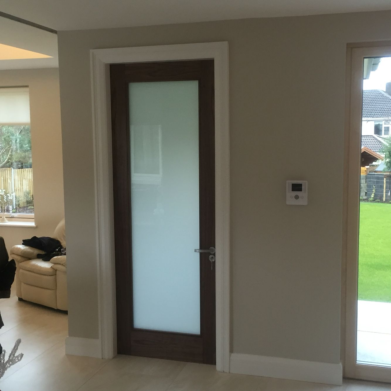 Walnut internal door with frosted glass