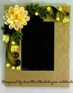 Photo frame decorated with quilled flowers  leaves made out of paper strips also rh no pinterest
