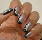 black and silver design nails