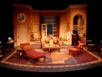Set props are usually furniture like chair, table and rugs ...