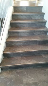 Luxury vinyl tile installed with custom insert stair ...