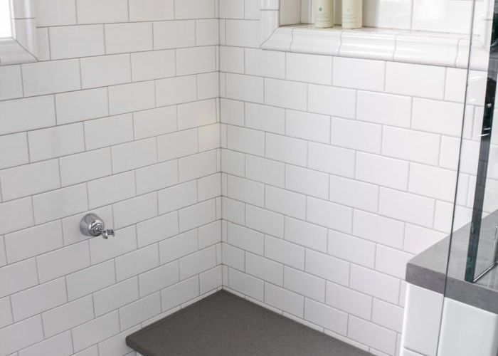 White subway tile with thin grey grout lines and built in shelving for the master shower great idea to add extra hand held holder back also pin by frankie edwards on bathroom ideas pinterest bench glass