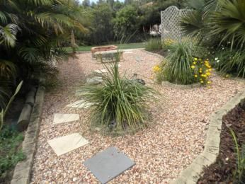 Landscaped Garden Design Using Pebbles With Vegetable Patch