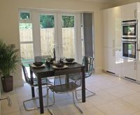 Vertical blinds are ideal for busy patio doors ...