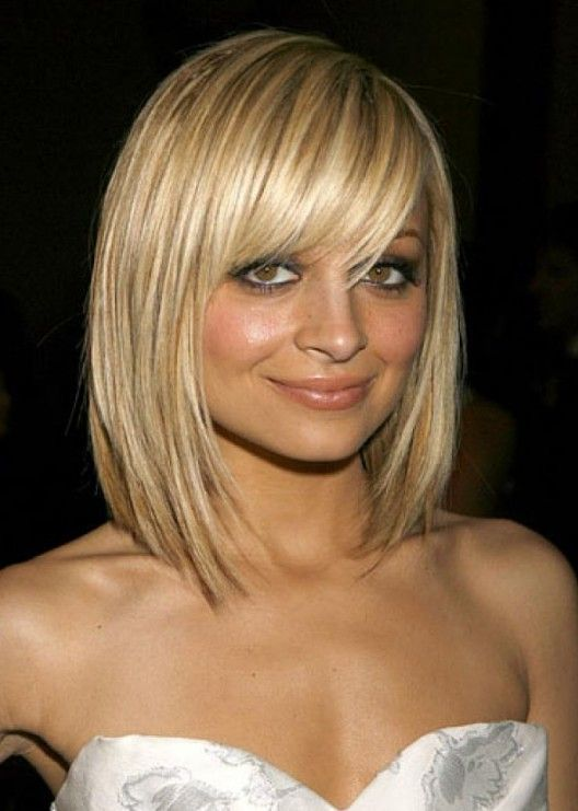 Pretty Textured Blonde Bob Haircut With Full Fringe Nicole