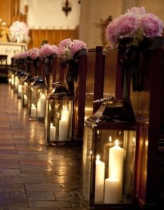 Glass lanterns and flower bouquets aisle decor for church or on reception tables also candles in create  super romantic lighting effect your rh pinterest