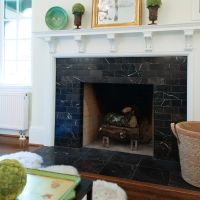 Fireplace Boasts Black Marble Surround & White Mantel