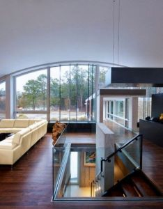 Surprisingly adapted to  difficult site arc house in east hampton by maziar behrooz architecture also  like that window and the thought of stairs sinking down foot rh pinterest