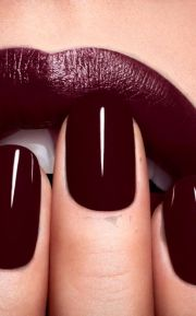 burgundy nail polish and lips stick