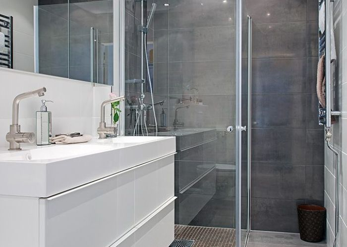 White clean modern bathroom gothenburg at its finest the charming masthuggsliden apartment like floor to wall grey tiles also neutral ba os pinterest