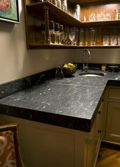 CURRENT TOP PICK FOR COUNTERTOP Jet Mist granite in a leather finish Maybe honed Looks