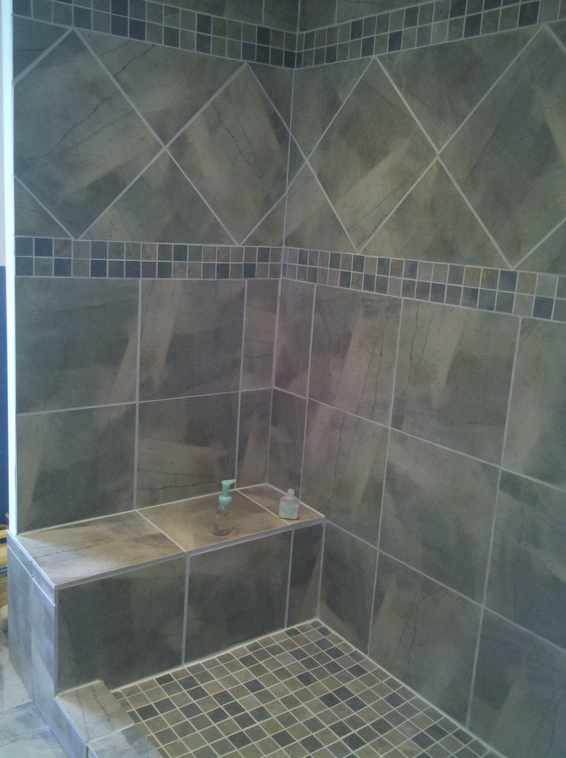 Sophisticated Gray Diagonal Tiled Shower Patern With Mosaic