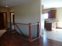 View from Living Area to Open Staircase and Kitchen/Dining ...