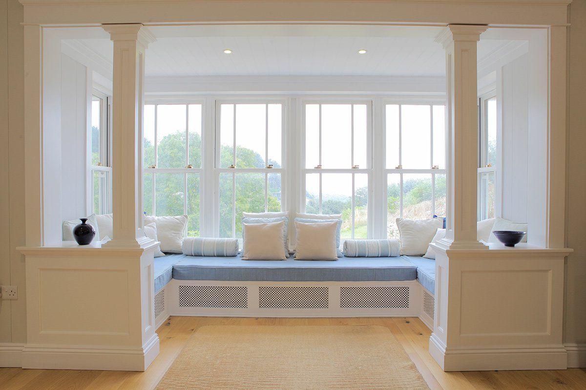 Stylish and Futuristic Bay Window with Window Seat Design