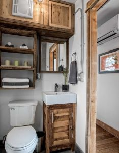 The freedom tiny house from minimalist homes llc  sq ft shipping container home with sleek modern interior also bathroom storage ideas tinybathrooms bathrooms pinterest rh