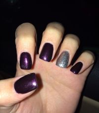 dark purple and silver nails.