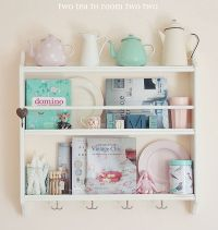 Tea pot collection on decorative plate rack from ikea