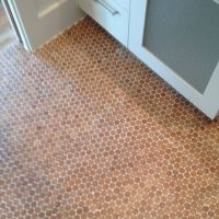 Recycled cork floor--great idea for laundry room.   For ...