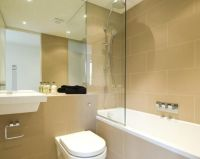 photo of beige white bathroom with bath floating sink ...