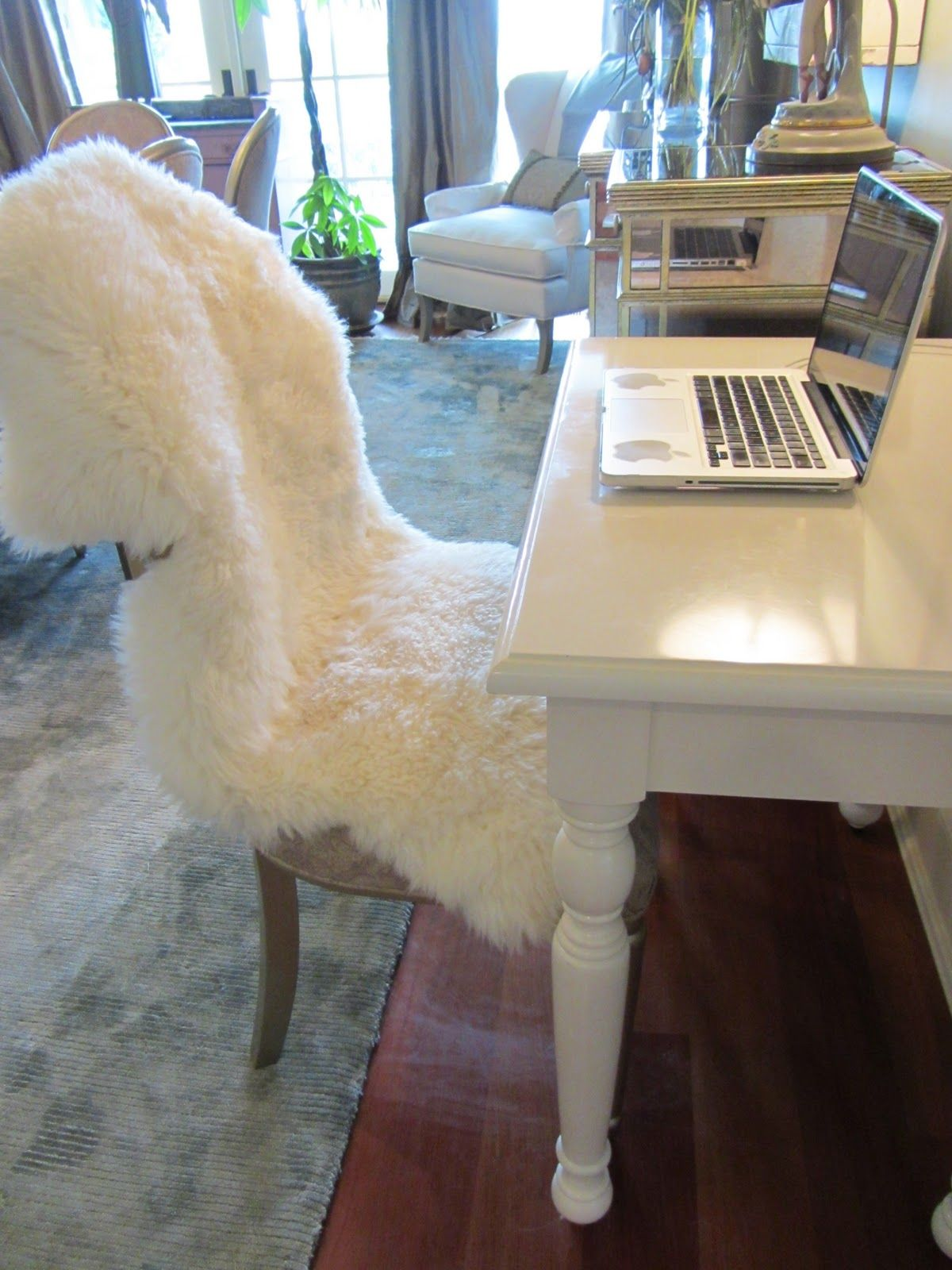 sheepskin rug on chair design set ikea throw for over the rocking