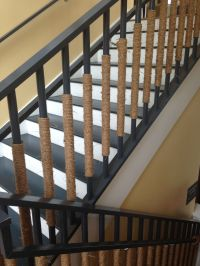 Wrap rope around stair railing good for a nautical theme ...