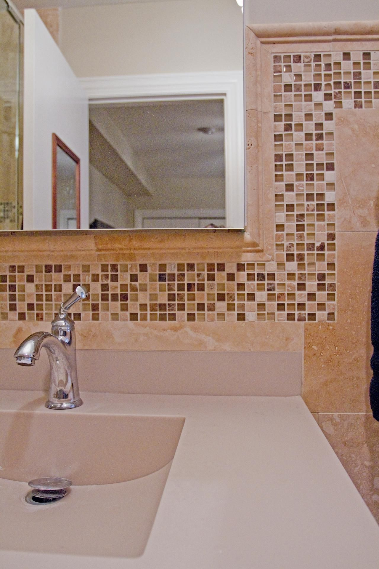 Mosaic tiles flow throughout the bathroom creating a