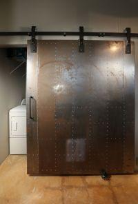 Industrial metal barn door - hidden laundry | industrial ...