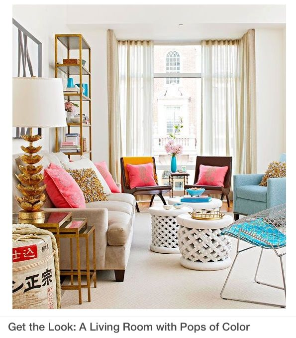 This city apartment living room looks fabulous decked out in pink cool toned turquoise and glitzy bronze accents love it pop of color the home also colours use gold different colour sofas like rh pinterest