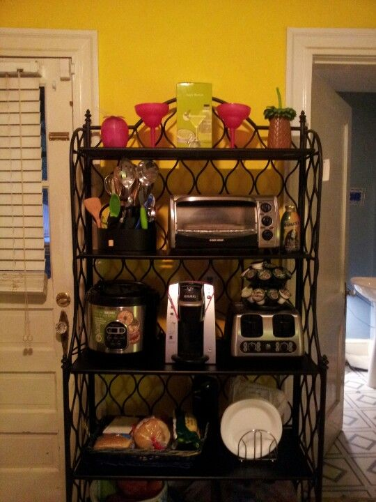 small apt or dorm room small appliances on a bakers rack