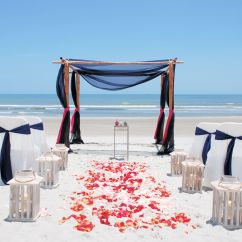 Beach Wedding Chair Decoration Ideas Swivel Wikipedia Setup With 4 Post Bamboo Navy Blue Sheers