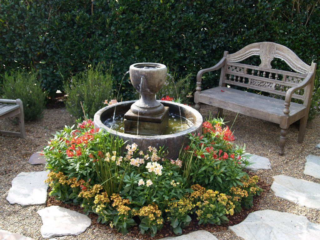 small garden idea with fountain in round bowl with low