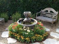 small garden idea with fountain in round bowl with low ...