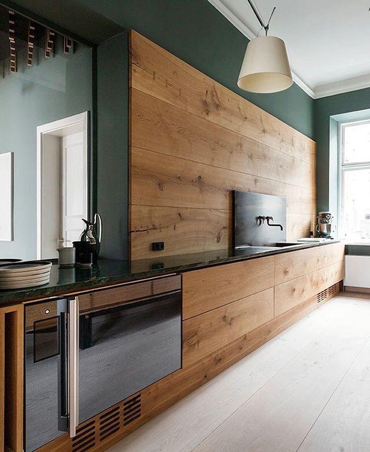 Modern Kitchen With Sleek Walnut Cabinets And Dark Green