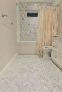 Grey marble tile in herringbone pattern on floor. Grey ...