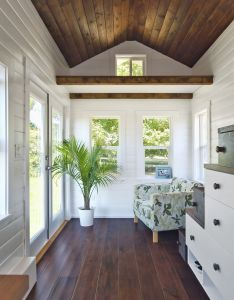 This house has barely anything in it  guess that   what makes so beautiful amalfi tiny wood floors and ceiling white walls also tinyhome pine interior tinny houses pinterest rh